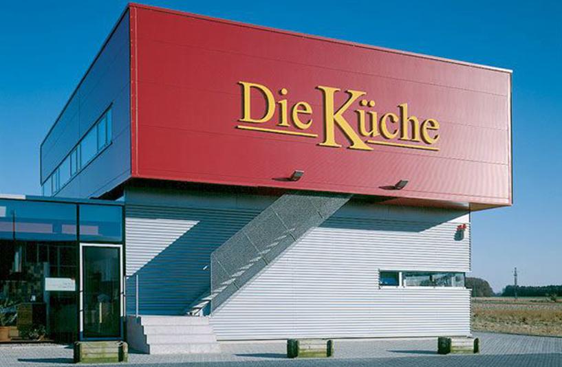 Die Küche - Logo am Gebäude